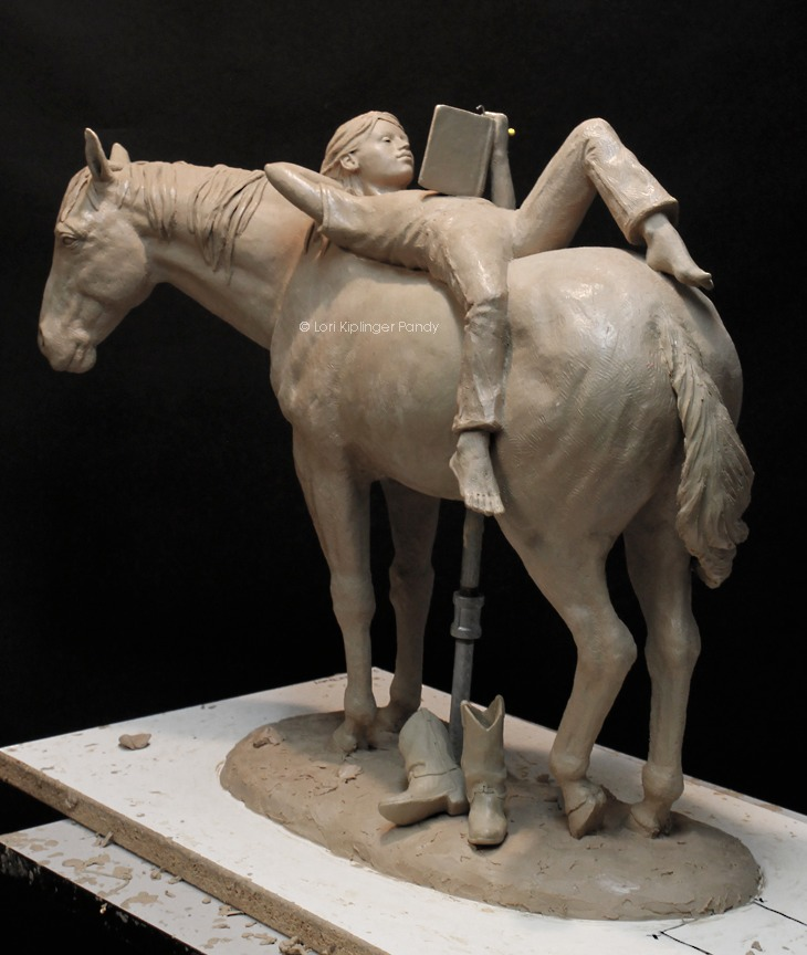 Clay Sculpture of a girl reading a book on the back of a horse ©Lori KiplingerPandy