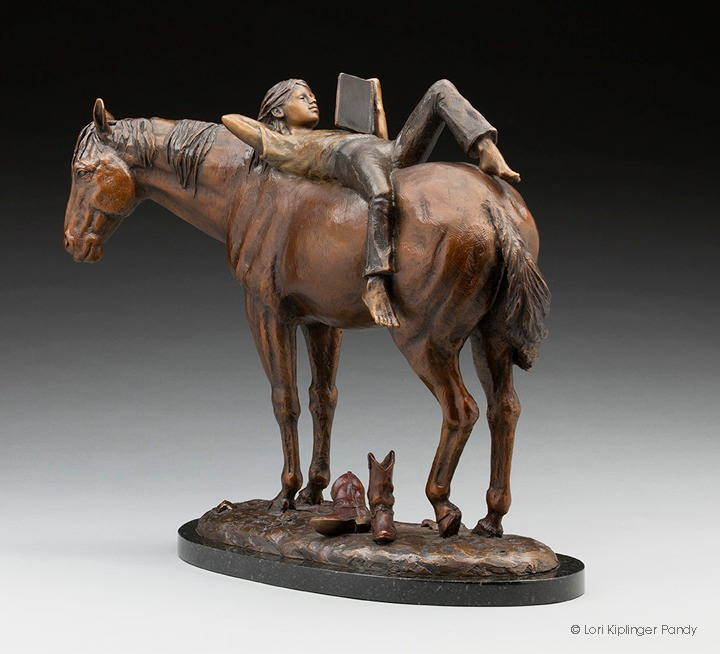 Girl reading book on horseback bronze sculpture. Lori Kiplinger Pandy art