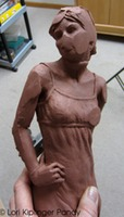 Fixing a damaged sculpture in clay ©Lori Kiplinger Pandy