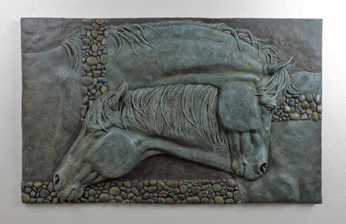 Bas Relief wall sculpture of two horses with necks entwined ©Lori Kiplinger Pandy