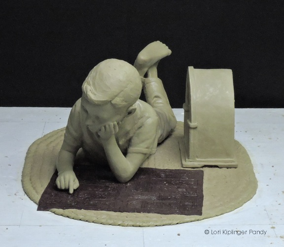 """Sunday Comic"" clay sculpture of boy reading comics to 1930's radio completed and ready to go to the foundry ©Lori Kiplinger Pandy"