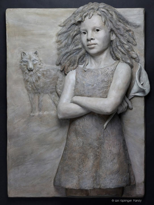 African American girl sculpture. Bas Relief sculpture by Lori Kiplinger Pandy. Symbolism includes flower and wolf