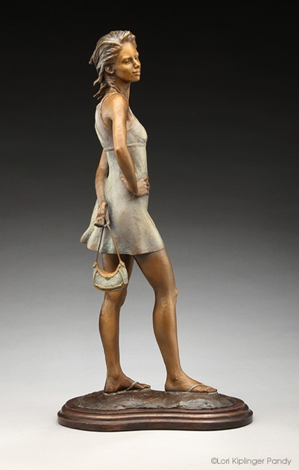 """Waiting on the #9"" ©Lori Kiplinger Pandy bronze sculpture of a young woman holding her purse and waiting for the train."
